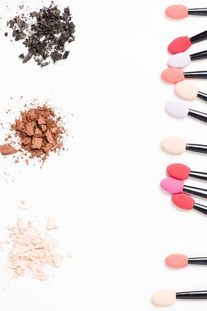 Professional makeup brush and black, brown, beige eye shadow on white background with copy space. Cosmetics, beauty, fashion, youth, care concept Archivio Fotografico - 138363371