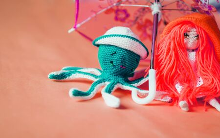 Crochet octopus doll isolated on yellow background