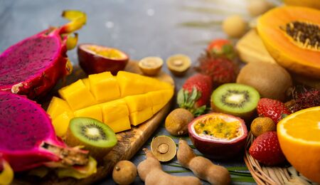 Exotic fruits and tropical leaves