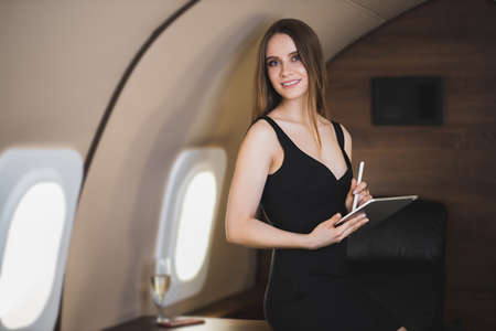 Attractive woman in private jet
