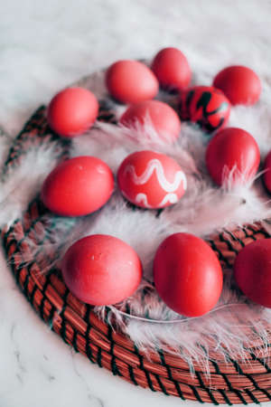 Abstract red eggs on white fluff close-up. Easter spring concept Stock fotó