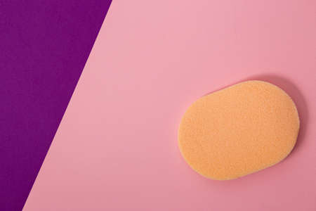 Closeup orange cosmetic sponge for makeup on pink background Stock fotó