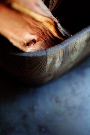 Firewood in a wooden basket