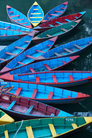 Colorful boats on a lake in Pokhara, Nepal Stock Photo