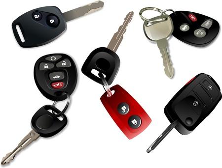 keys isolated: Cinco llaves con control remoto aisladas sobre fondo blanco