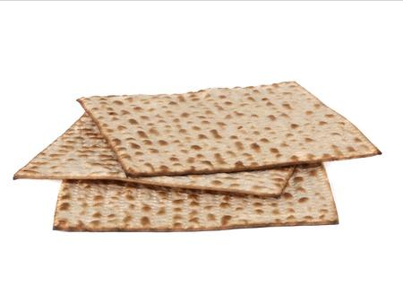 jewry: Three matzot on white background. Matzo - jewish passover bread within pottle
