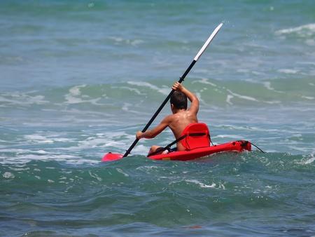 boy rowing in sea kayak Stock Photo