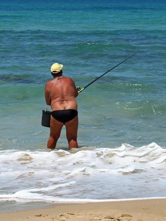 man fishing at the beach  Stock Photo