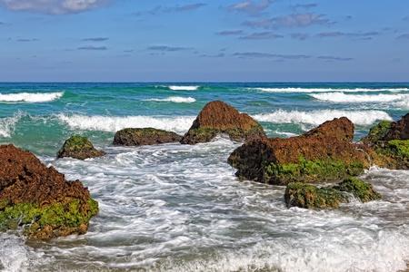Huge stones in surf waves. Picturesque coast Mediterranean sea,Netanya, Israel  photo