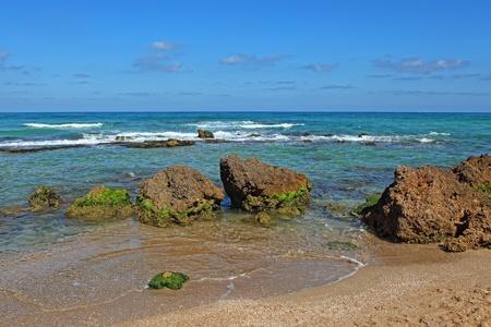Huge stones and sea. Coast Mediterranean sea photo
