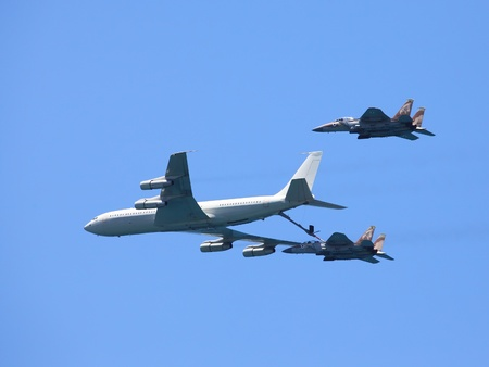 TEL AVIV, ISRAEL - MAY 10: An F-15 & Boeing 707 demonstrate an in flight refuel at the Tel Aviv Air Show dedicated to the Israel Editorial