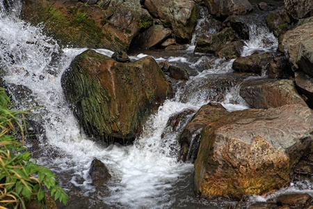 Small waterfall on a creek ,stream and rocks  Stock Photo