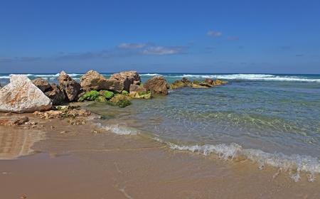Huge stones and sea. Coast Mediterranean sea,Netanya, Israel  photo