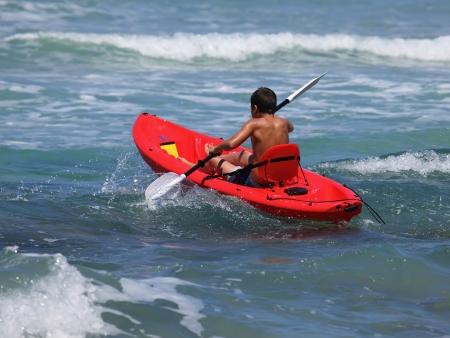 boy rowing in sea kayak Stock fotó
