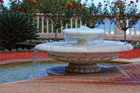 Small decorative fountain in a Bahai Gardens, Haifa, Israel  photo