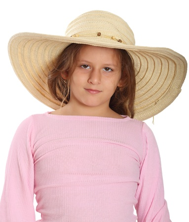 Portrait of little girl with brown eyes wearing straw hat on white  photo