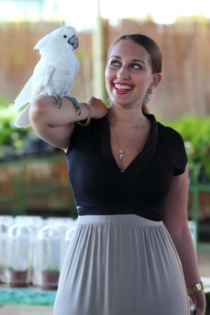 jewess: young woman with beautiful white parrot
