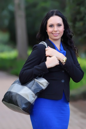 Young pretty business woman in autumn park  Stock fotó