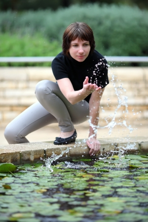 young woman near the fountain Stock Photo - 17159464