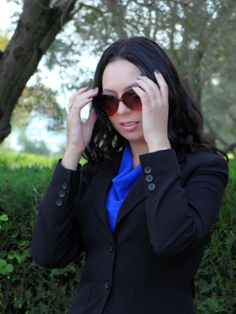 Young pretty business woman with sunglasses  photo