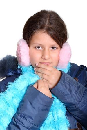 muff: Portrait of cute little girl in pink earmuffs