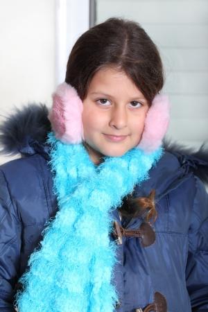 jewess: Portrait of cute little girl in pink earmuffs