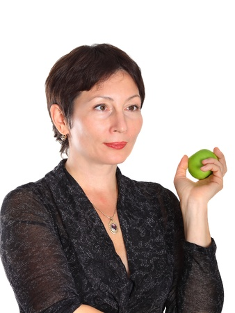 jewess: A middle aged woman with green apple on white background