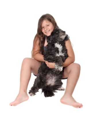 brown and black dog face: little girl with dog on a white background Stock Photo