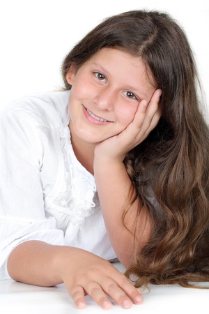 jewess: Close up portrait of a pretty young schoolgirl with dark hair and brown eyes smiling charmingly  Stock Photo