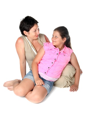 mother and daughter sitting on the floor photo