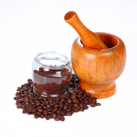 Mortar and pestle with black coffee and coffee beans  on white background photo
