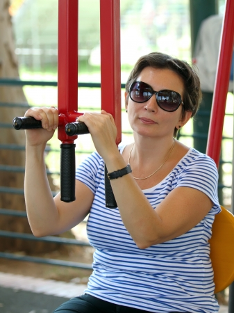 jewess: a woman on a gym machine in the public fitness park