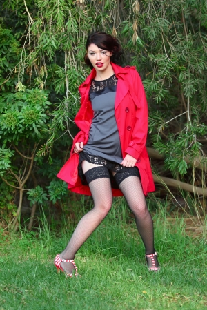 jewess: Beautiful women in red coat posing in park