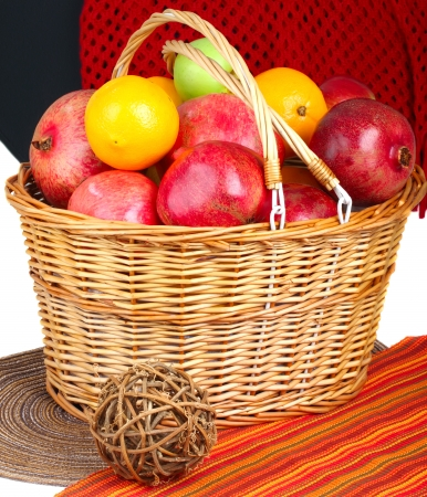 Assorted fruits in wicker basket closeup  photo