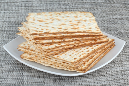 matzos: Closeup of Matzah on Plate which is the unleavened bread served at Jewish Passover dinners Stock Photo