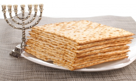 unleavened: Closeup of Matzah on Plate which is the unleavened bread served at Jewish Passover dinners Stock Photo