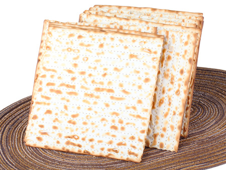 matzah: Closeup of Matzah on Plate which is the unleavened bread served at Jewish Passover dinners