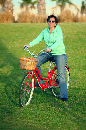 jewess: Woman with her bike on the grass