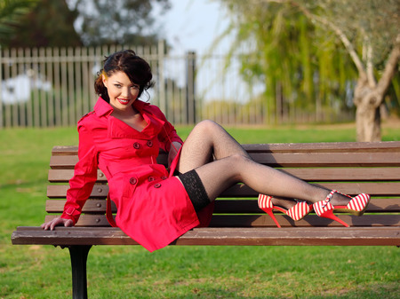 jewess: young women in red coat posing in park  Stock Photo