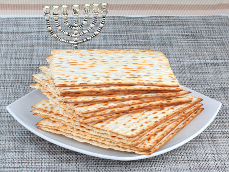 matzo: Closeup of Matzah on Plate which is the unleavened bread served at Jewish Passover dinners