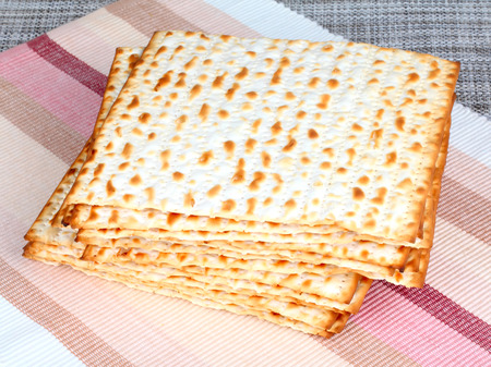 Matzo (or matzah) is bread traditionally eaten by Jews during the week-long Passover holiday  Stock Photo