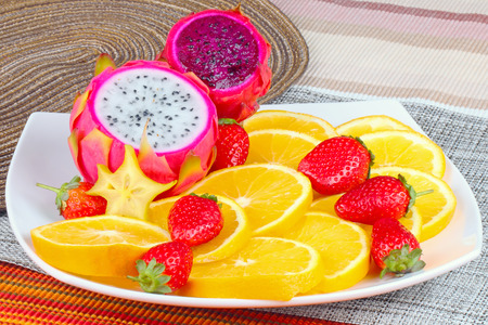 Exotic Fruit Dish with Dragon Fruit, pitahaya,strawberri es and orange slices  photo