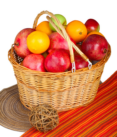 Assorted fruits in wicker basket closeup  Stock Photo