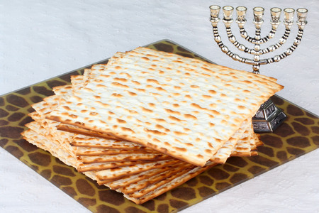 unleavened: Closeup of Matzah on Plate which is the unleavened bread served at Jewish Passover dinners