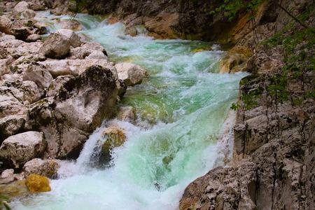 julian: Mountain river flow between stone.Waterfall Savica, Slovenia