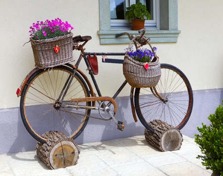 Old bicycle with flowers as decoration Stock fotó