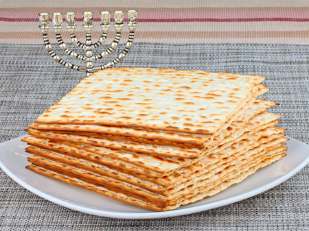jewry: Closeup of Matzah on Plate which is the unleavened bread served at Jewish Passover dinners Stock Photo