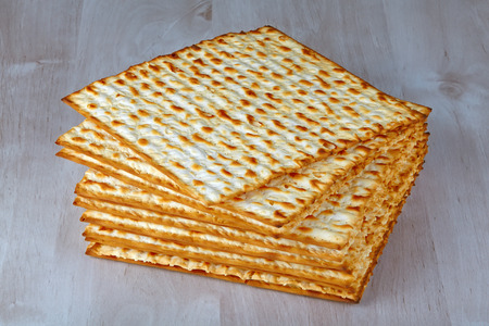 Closeup of Matzah on wooden table which is the unleavened bread served at Jewish Passover dinners Stock fotó