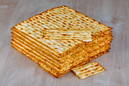matzot: Closeup of Matzah on wooden table which is the unleavened bread served at Jewish Passover dinners Stock Photo