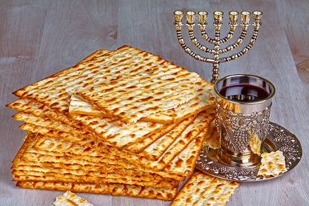 matzoth: Closeup of Matzah on Plate which is the unleavened bread served at Jewish Passover dinners Stock Photo